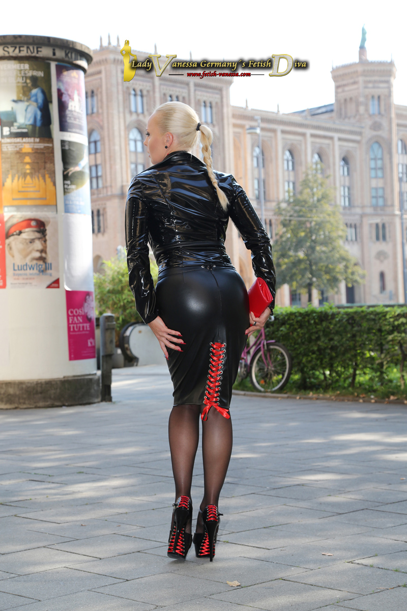 In a new outfit by Fetish Atelier (http://www.fetish-atelier.com), consisting of a lace-up skirt and a special patent leather jacket, the Fetish Diva Lady Vanessa presents herself in Munich on Maximilianstraße at a Sunday morning.