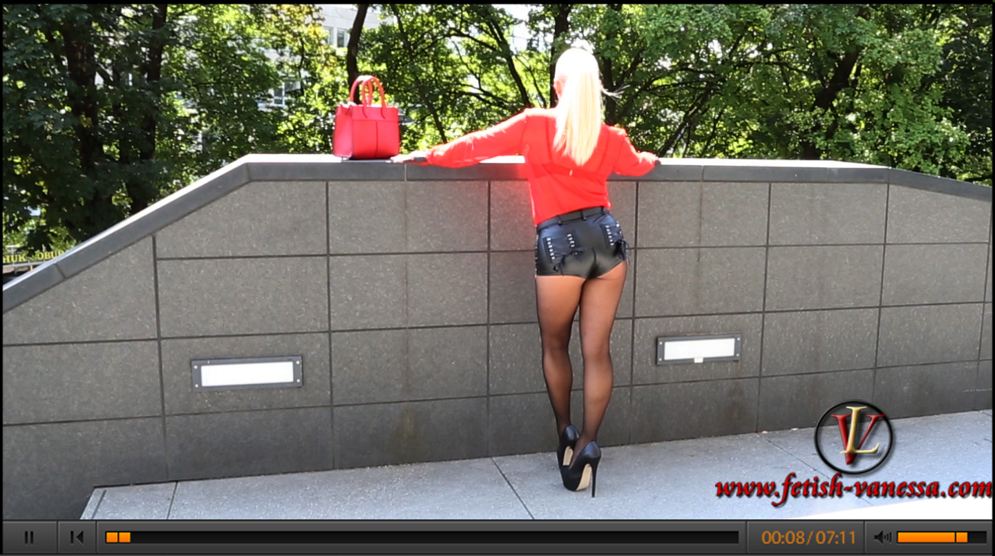 With a transparent red blouse by Fetish Atelier (http://www.fetish-atelier.com), leather hot pants and with ultra high high heels Lady Vanessa appeared to the photo shooting in Munich.