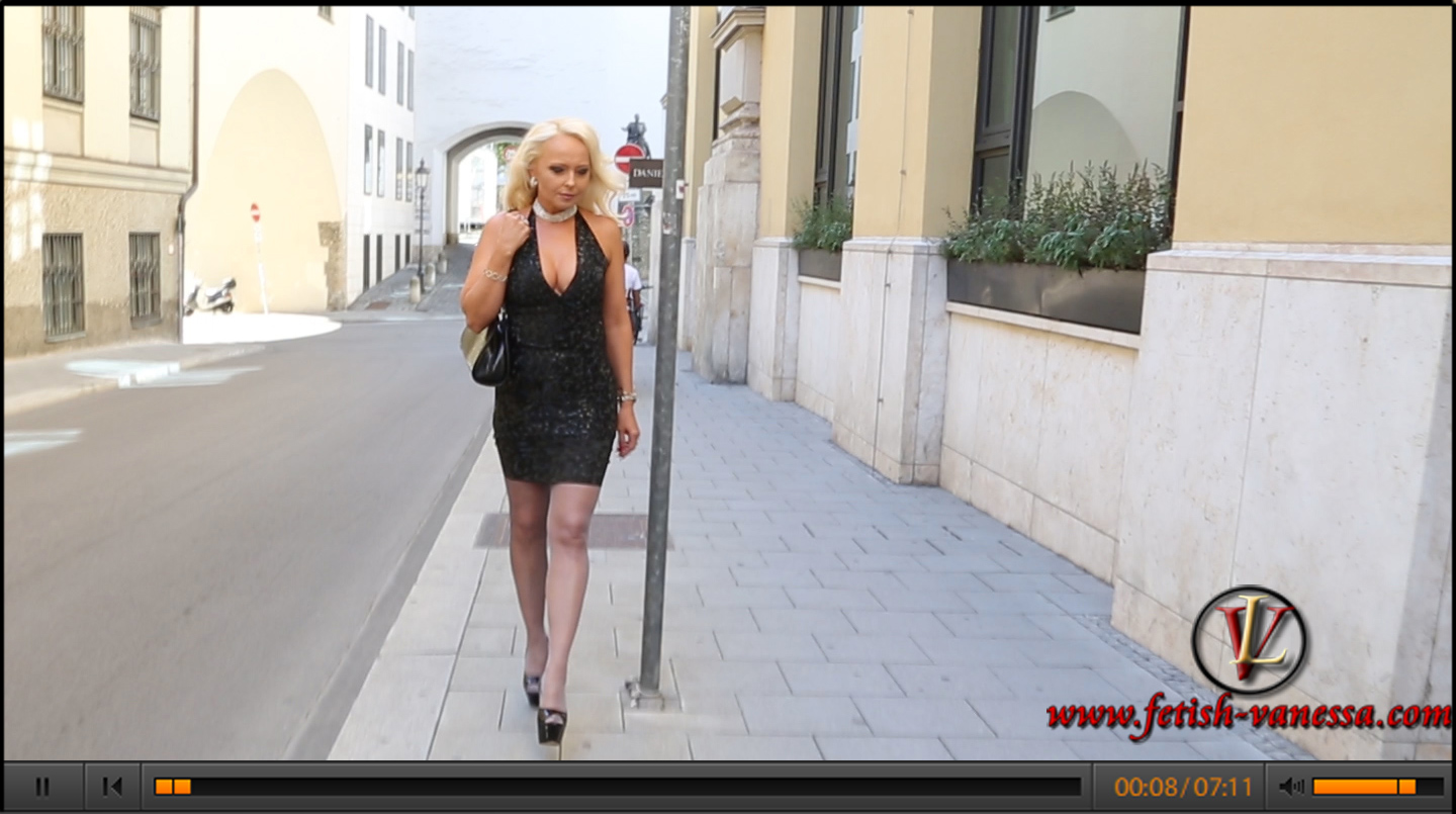 Lady Vanessa in a latex outfit by Jé Gilbert (http://www.fetish-fantaisies.com/) and nylons by Cervin Paris. The new latex material has a special gloss texture. This wonderful latex video was taken in front of the opera in Munich.
