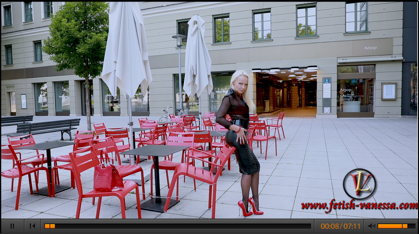 In the new update of the Fetish Diva Lady Vanessa you can see her in a black wetlook skirt by Noir Handmade. The weather was perfect to wear her transparent black blouse from Fetish-Atelier over a red vinyl bra. The outfit is completed by Giaro's red shoes.